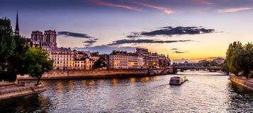 Sunset view from Seine. Watching a summer sunset over Seine near Notre Dame de Paris Stock Photo