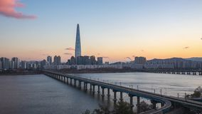 Sunset view of Seoul city skyline with Han river in Seoul city, South Korea