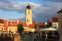 Tower of Council and Small Square in Sibiu. Sunset view of Sibiu city with Tower of Council in the background and dramatic sky. Small Square Piata Mica from stock photos
