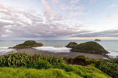 Sunset view of Sugar Loaf Islands, New Plymouth, New Zealand stock photo