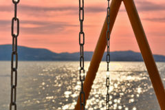 Sunset. View and a swing royalty free stock images