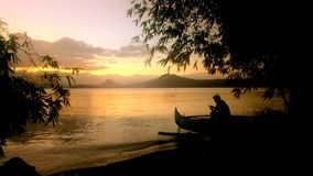 Sunset view of Taal Lake. Sillouette of a man in a lake Royalty Free Stock Photos