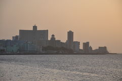 Sunset view to buildings on the Malecon, Havana. Sunset view of the sea and buildings on the Malecon, Havana, Cuba Royalty Free Stock Photo