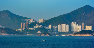 Sunset view to residential apartments building in Hong Kong seaf Stock Photo