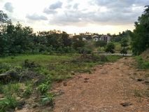 Sunset view from on top hill. View of sunset from jungle beside highway Stock Images