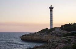 Sunset view of torredembarra's beacon, in Tarragona, Spain Stock Photos