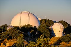 Sunset view towards observatories on top of Mt Hamilton, San Jose. Sunset view towards Shane Observatory and the Automated Planet Finder telescope, Mt Hamilton royalty free stock photography