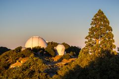 Sunset view towards observatories on top of Mt Hamilton, San Jose. Sunset view towards Shane Observatory and the Automated Planet Finder telescope, Mt Hamilton royalty free stock photo