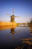 Sunset view at typical windmill at Kinderdijk, Holland. Stock Photos