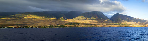 Sunset view of the west coast on the island of Maui Hawaii. This beautiful sunset view of the West Coast of Maui Hawaii shows the tall mountains, valleys and Stock Images