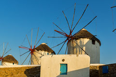 Sunset view of White windmills on the island of Mykonos, Greece Royalty Free Stock Image