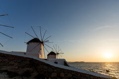 Sunset view of White windmills on the island of Mykonos, Greece Stock Photography