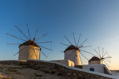 Sunset view of White windmills on the island of Mykonos, Greece Stock Photo