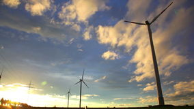 Sunset view at wind turbines under evening sun stock video