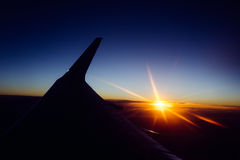 Sunset view from the window of an airplane Stock Photography