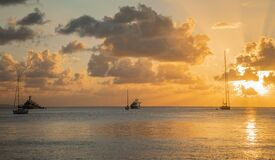 Sunset view of yachts anchored in the lagoon, Britannia bay, Mustique island, Saint Vincent and the Grenadines, Caribbean sea