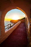 Sunset viewed from Cova d'en Xoroi at Menorca island, Spain. Royalty Free Stock Photography