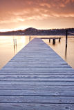 Sunset Viewed from a Dock on a Mountain Lake Royalty Free Stock Photo
