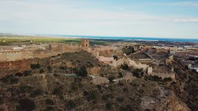 View from air on castle Sagunto near Valencia. Sunset views on ruined walls of old castle near seashore stock footage