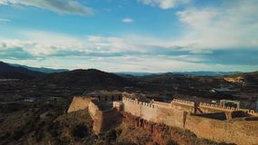 View from air on castle Sagunto near Valencia. Sunset views on ruined walls of old castle near seashore stock video
