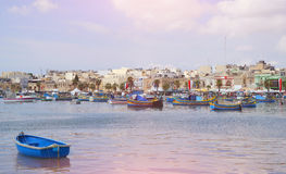 Sunset in the village of fishermen Marsaxlokk in Malta. Royalty Free Stock Photography