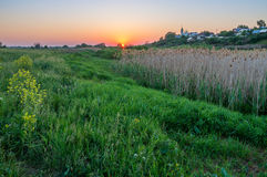 Sunset in the village Stock Images