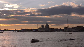 Sunset in Vinece. Cathedral of Santa Maria della Salute stock video footage