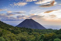 Sunset in a volcano base stock images