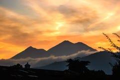 Sunset volcano view. Sunset view of Fuego & Acatenango volcanoes near Antigua, Guatemala, Central America Stock Photo