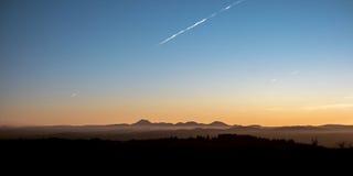 Sunset on volcanoes mountains Stock Photo