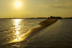 Sunset on the Volga River. Golden sunset on the Volga River in Astrakhan. Sandy spit royalty free stock images
