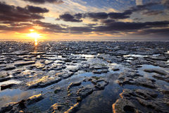 Sunset at the Wadden sea - Netherlands Stock Photo