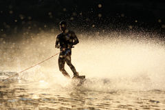 Sunset Wakeboarding. Wakeboard Action on a lake at sunset royalty free stock photography