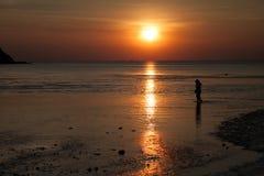 Sunset. Wallpaper man orange Royalty Free Stock Photo