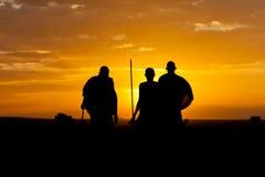 Sunset warriors. Three masai warriors in Africa (Kenya royalty free stock photo
