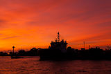 Sunset with Warship in the sea Royalty Free Stock Images