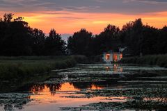 Dutch Houseboat at a Colorful Sunset royalty free stock images