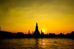 Sunset at Wat Arun Rajwararam. Wat Arun Rajwararam and Chao Phraya river in the evening scene, Thailand Royalty Free Stock Image
