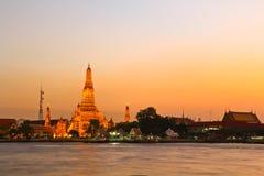 Sunset at Wat Arun Rajwararam. Wat Arun Rajwararam and Chao Phraya river in the evening scene, Thailand Stock Photo