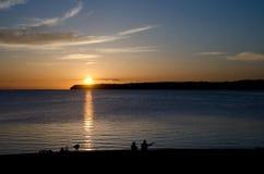 Sunset watchers at Semiahmoo Bay - 1. Sunset watchers at Semiahmoo Split looking at bay royalty free stock photo
