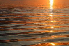 Sunset water background. Beautiful sunset water close-up background Royalty Free Stock Photo