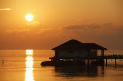 Sunset with water bungalow in the Indian Ocean, Ma Royalty Free Stock Images