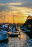 Sunset on the water. Docked boats sunset Stock Photos