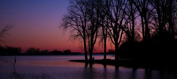 Sunset by the water. Picture taken by the board walk in Lachine Quebec royalty free stock image