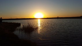 Sunset on the water. Sunset on a pond in Texas Stock Image