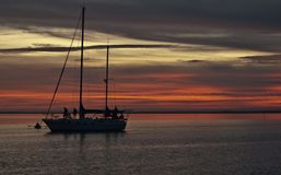 Sunset on the Water. Sailboat at sunset on Florida`s Gulf Coast royalty free stock photography