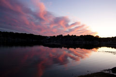 Sunset by water Royalty Free Stock Images
