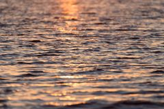 Sunset on the water. Photo of abstract background Royalty Free Stock Photo