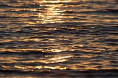 Sunset on the water. Photo of an abstract texture Stock Photos