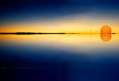 Sunset on water surface. Orange sunset on water surface with stars Royalty Free Stock Photography